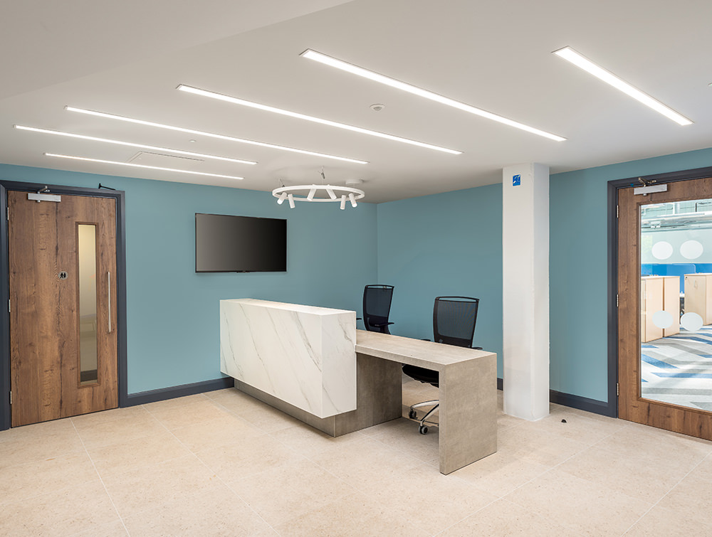 Precision Software Office Reception Desk with Overhead LED Lights and High Back Mesh Chairs