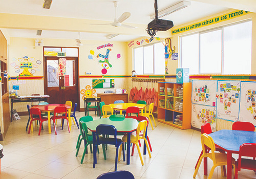 Preschool Classroom Multicolour Tables and Chairs Bookcase