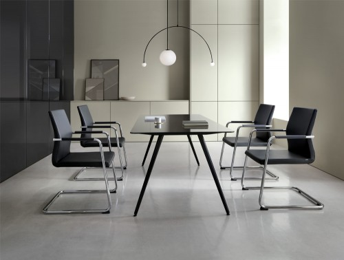 Profim Acos Executive Armchair in Conference Room with Chrome Cantilever Base with Black Glass Table and Stylish Ceiling Lighting