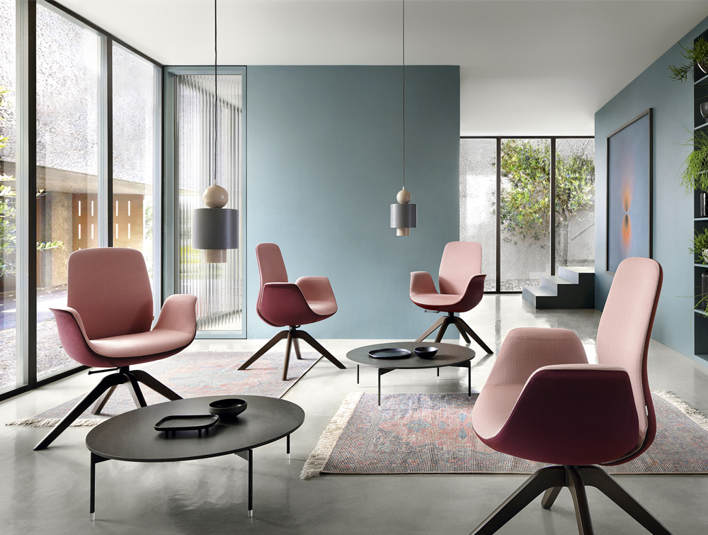 Profim Ellie Swivel Lounge Armchair in Pink with Dark Walnut Wooden Legs Round Low Cafe Table in Sitting Room