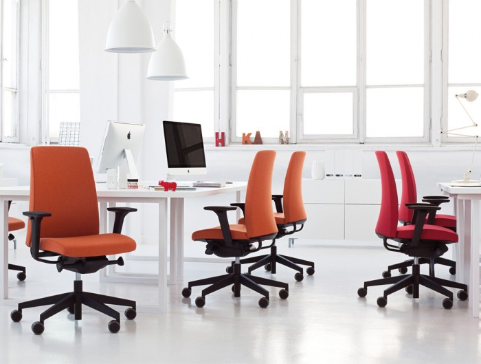 Profim Motto Swivel Comfy Ergonomic Chair Upholstered Red Finish in Modern Office with White Desk and Ceiling Lighting