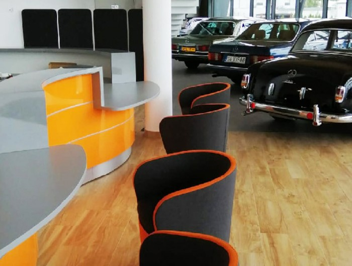 Profim Nu Spin Soft Seating Visitor Chair in Dark Grey and Orange with Reception Desk