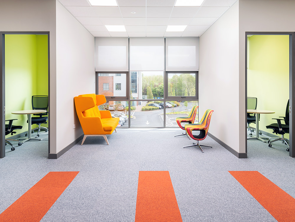 Profim October High Back Soft Seating Orange Chair and Profim Pellikan Chairs for Reception Lounge Areas
