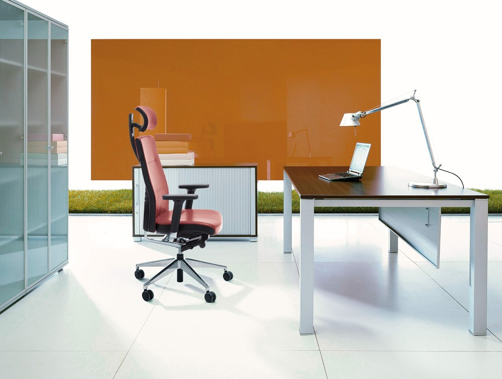 Profim one ergonomic chair with user backbone based adjustable backrest with headrest in an office