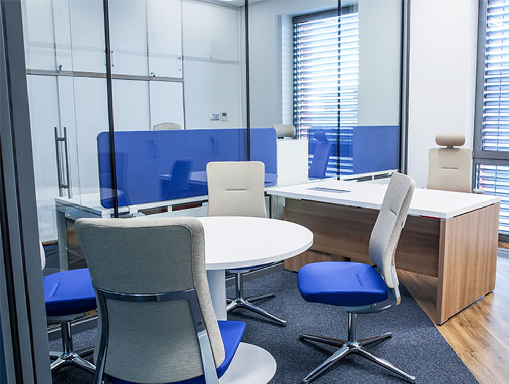Profim Violle Bicolour Ergonomic Chairs in Executive Office With or Without Headrest with Desk and Round Meeting Room Table