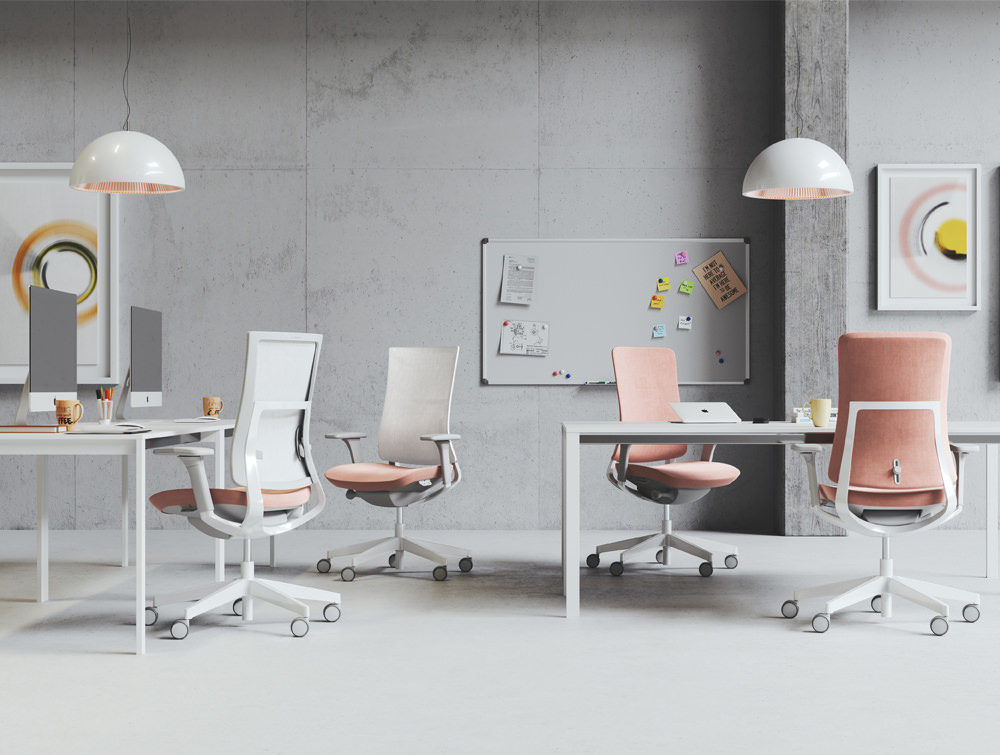 Profim Violle Swivel Executive Office Chair in Grey Frame and Pink Finish in Modern Open Space with Ceiling Lighting and Whiteboard