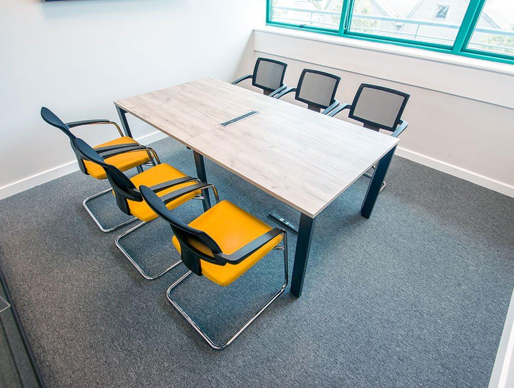 Six orange office chairs