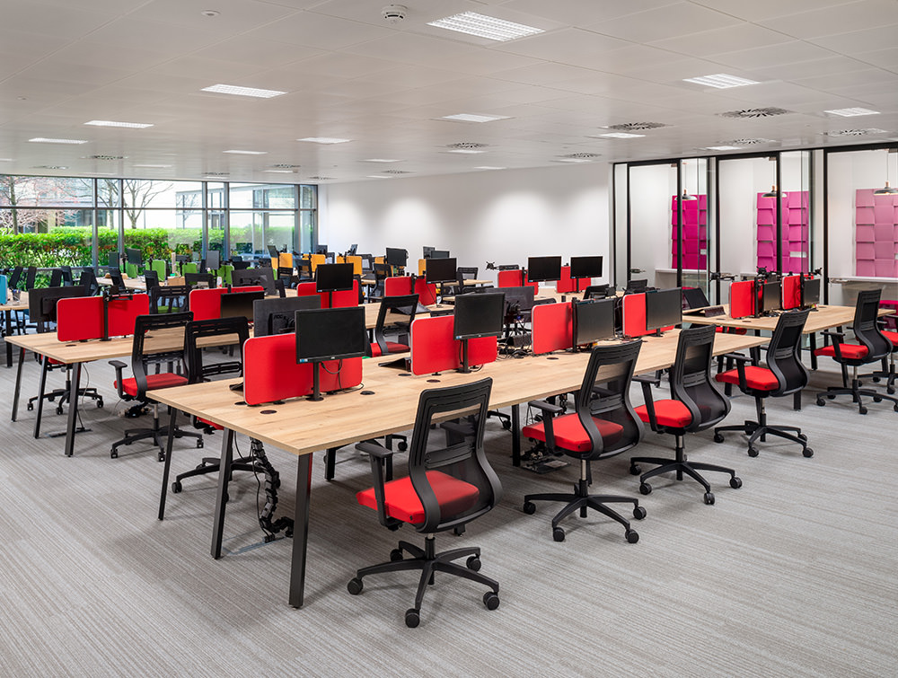 Social Talent Office Layout Beech Back to Back Desks with Red Desk Screens and Red Mesh Ergonomic Chairs