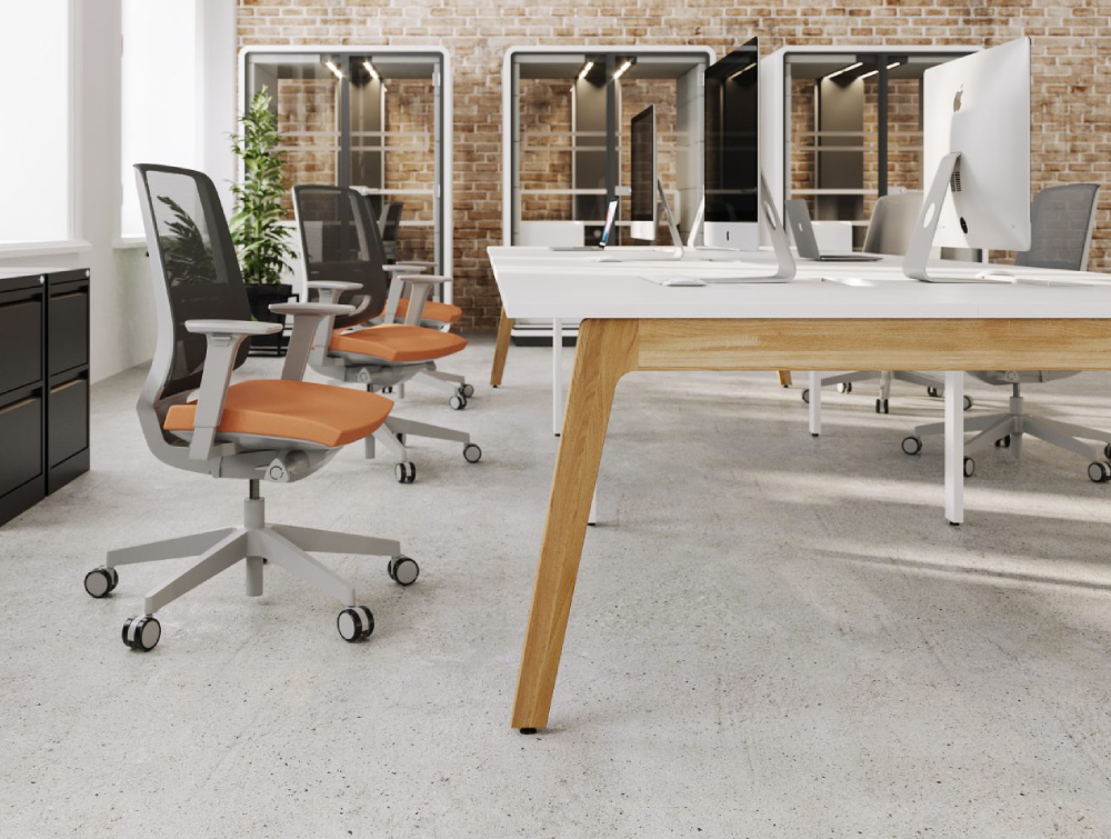 Switch Single Desk with Grey and Orange Task Chairs and White Pods Side View