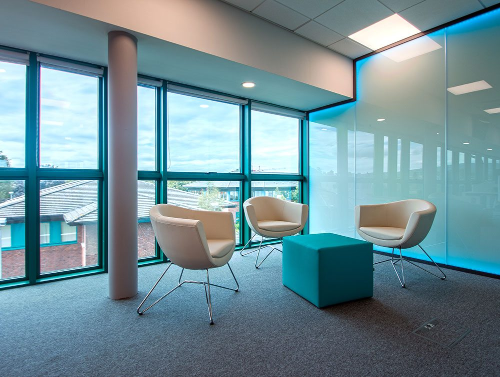 Three cream colour office chairs