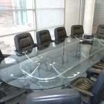 Used glass Boardroom table with 12 leather chairs
