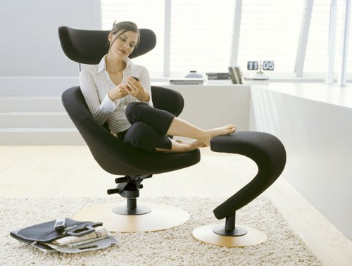 Varier-Peel-Chair-in-Black-Fabric-and-Wooden-Trumpet-Base-with-Footrest-in-Home-Setting