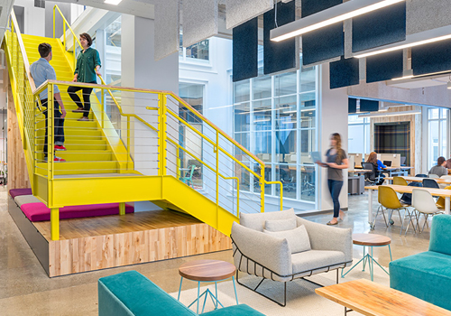 Funky Office with Bright Yellow Staircase