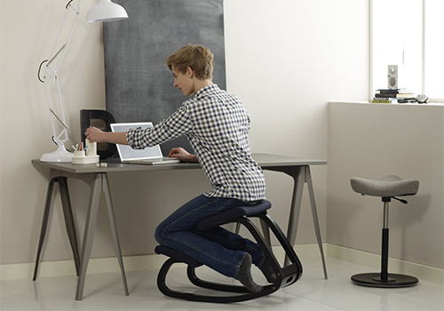 Man Working in an Ergonomic Kneeling Chair