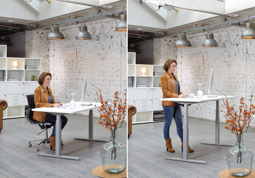 woman using sit-stand desk