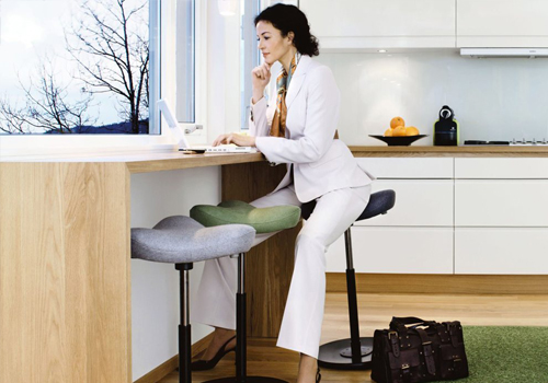 Varier-Move-Sit-Stand-Stool-with-user