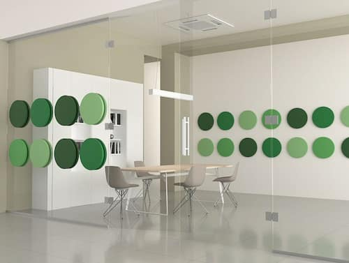 Green colour round office acoustic wall panel on glass wall of meeting room