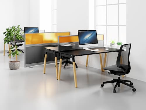 Office layout with desk screens and freestanding partitions for social distancing