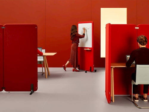 People working in office with acoustic privacy screens