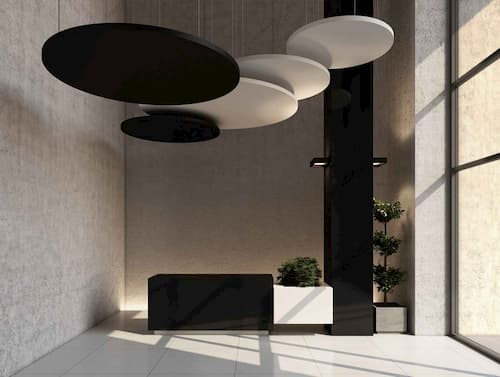 Black and white round ceiling hanging panels in office