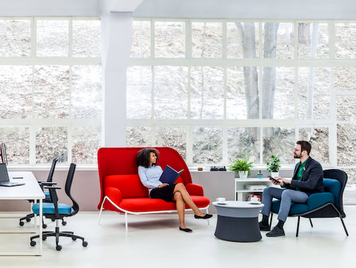 employees talking on sofa in break room