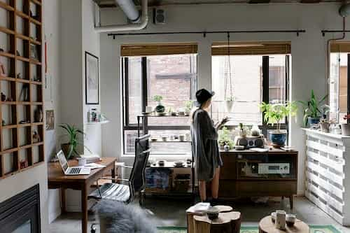 Modern workspace in home with natural light and plants