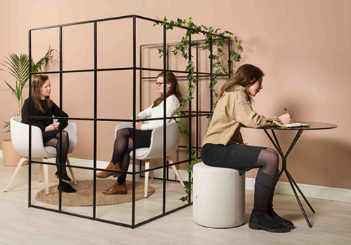 Palisade-Metal-Grid-Office-Space-Divider-with-Lounge-Chair-Round-Table-and-Pouffe