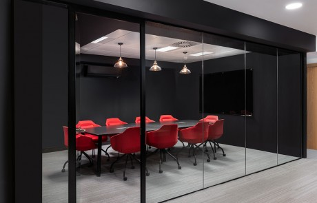 Social-Talent-Office-Layout-Red-Ultra-Meeting-Room-Chairs-with-Black-Meeting-Room-Table